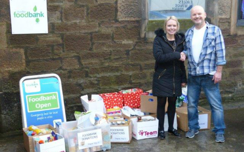 Dundee solicitor gives local food bank a festive boost